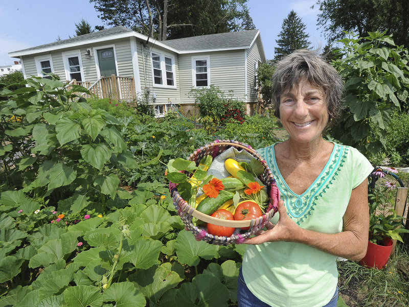 Liberty Bryer grows vegetables in a 2,000-square-foot community garden in front of her home in South Portland's Meetinghouse Hill neighborhood. The harvest will be given to four soup kitchen sites and 42 agencies in Cumberland County.