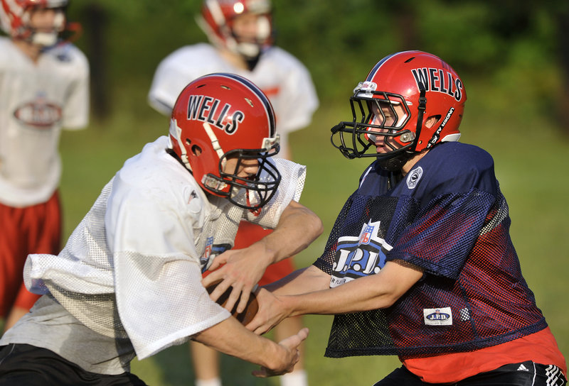 Wells quarterback Paul McDonough not only can hand off the ball, but hands off praise to his teammates as the bid for a title gets under way.