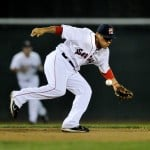 Sea Dog shortstop Ryan Dent picks up an error in the second inning while trying to chase down a ball hit up the middle.