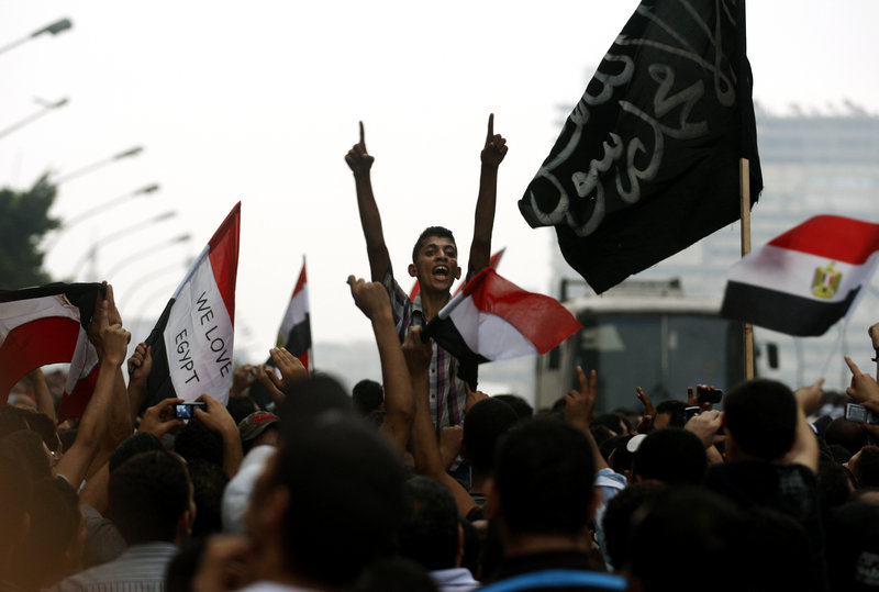 Egyptians chant anti-Israeli slogans Saturday in front of the Israeli Embassy in Cairo. Sentiment against Israel has increased in Egypt following the ouster of Hosni Mubarak.