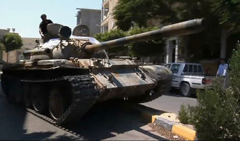 Rebels maneuver a captured tank in Zawiya, Libya, on Friday as they battled troops loyal to Moammar Gadhafi to gain control of the strategic central square in the city.