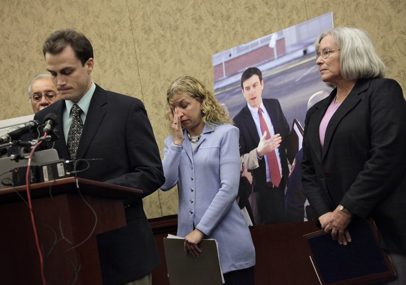 Gabe Zimmerman, the slain aide to Rep. Gabrielle Giffords, is remembered during a July ceremony on Capitol Hill. Rep. Debbie Wasserman Schultz, D-Fla., center, stands with Gabe's mother Emily Nottingham, right, and brother Ben Zimmerman as they introduce a bill to name a room in the Capitol complex after the congressional assistant. Giffords called Ross Zimmerman, Gabe's father, to express her condolences after learning about her aide's death.
