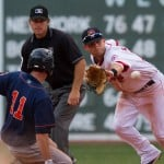 Ryan Khoury of the Portland Sea Dogs takes the throw Saturday as Jon Malo of the Binghamton Mets slides into second base with a ninth-inning double at Fenway Park. Malo didn t score, but Binghamton came away with a 6-4 victory in 11 innings.