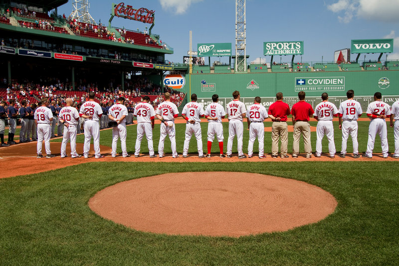 The Portland Sea Dogs line up along the first-base line Saturday for the national anthem at Fenway Park prior to the game against the Binghamton Mets. Binghamton came away with a 6-4 victory in 11 innings.
