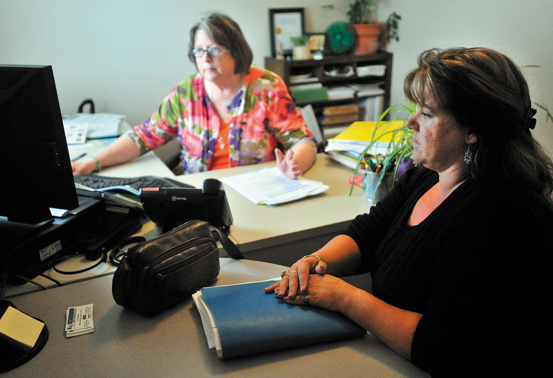 Carol Homer, a homeownership support counselor, center, discusses mortgage options with Lynne Choate, 35, of Winslow at the Kennebec Valley Community Action Program office in Waterville.