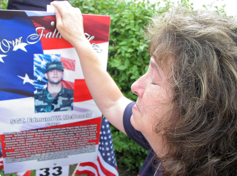 Kathy McDonald of Casco has a moment of silence for her son Sgt. Edmund W. McDonald, who was killed while in service in Kabul, Afghanistan, on March 28, 2007. The family gathered on Route 1 in Saco on Sunday to thank runners and to run themselves.