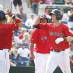 Portland's Mark Wagner, left, congratulates Jeremy Hazelbaker, foreground, and Reynaldo Rodriguez after all three scored on Hazelbaker's home run in the fifth inning that gave Portland a brief 5-4 lead against the Binghamton Mets on Sunday at Hadlock Field.