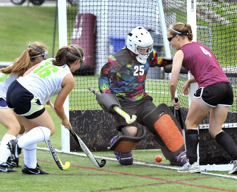 Yarmouth's Susannah Daggett slips a shot past Greely keeper Michelle Gray for a goal on Monday in Cape Elizabeth. Yarmouth and Greely were among the 16 squads that took part in Cape's annual play day, during which teams play five or six 25-minute games.
