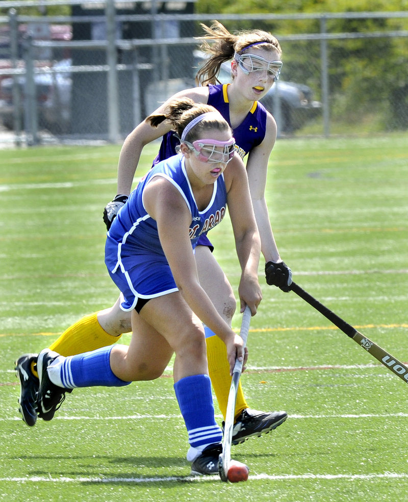 Lindsey Smith of Mt. Ararat carries the ball as Sarah Laquerre of Cheverus defends on Monday in Cape Elizabeth.
