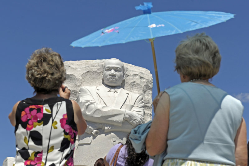 """People view the new Martin Luther King Jr. Memorial in Washington, D.C., on Monday. Hundreds filed through the entrance to the memorial site, which will be dedicated Sunday on the 48th anniversary of the 1963 March on Washington and King's famous """"I Have a Dream"""" speech."""