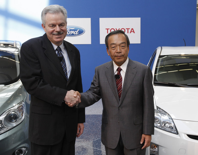 The Associated Press Derrick Kuzak, Ford's product development chief, left, and Takeshi Uchiyamada, Toyota's head of research and development, shown at a news conference in Dearborn, Mich., on Monday, have teamed to develop more fuel-efficient trucks.
