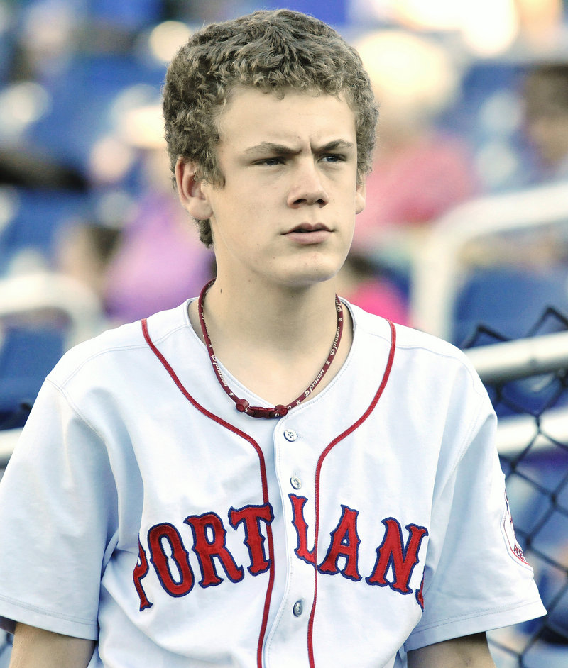 Elliott Speirs, a Sea Dogs bat boy, is two years younger than Bryce Harper, but their worlds are far apart.