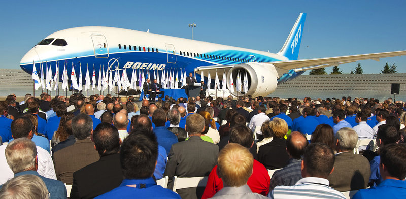 Speakers announce Federal Aviation Administration certification of the Boeing 787 for commercial flight on Friday in Everett, Wash., with the first 787 providing the backdrop.