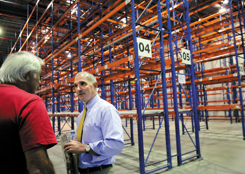 """Nick Alberding, co-owner of Pine State Trading Co., tours the refrigerated storage at the former Associated Grocers warehouse before an Aug. 8 auction for AG's buildings in Gardiner. """"The temperature-controlled space is really critical to our business,"""" he says."""