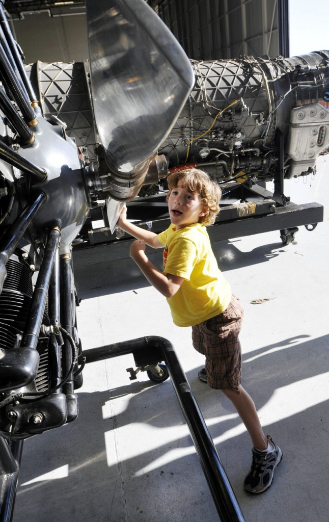 C.J. Stafford, 6, of Portland turns a Hamilton Standard Propeller on display at the Great State of Maine Air Show at the former Brunswick Naval Air Station on Friday.