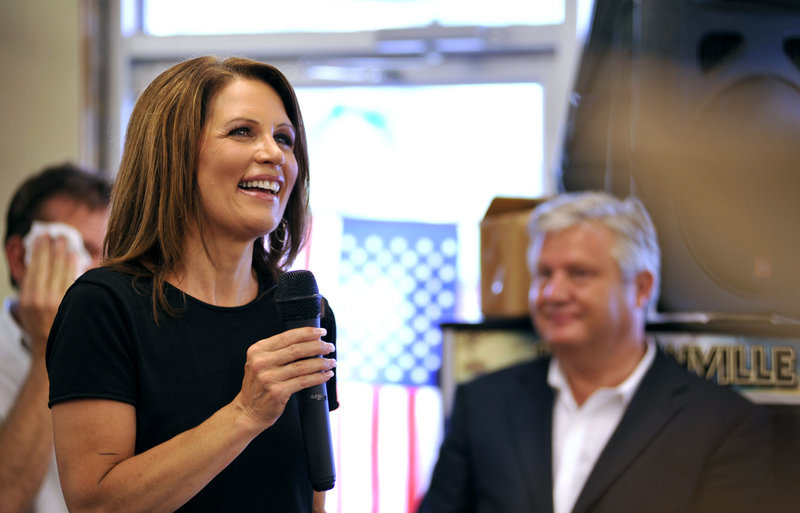 Presidential hopeful Michele Bachmann speaks to supporters Friday at Angie's Subs in Jacksonville Beach, Fla. At right is her husband, Marcus Bachmann.