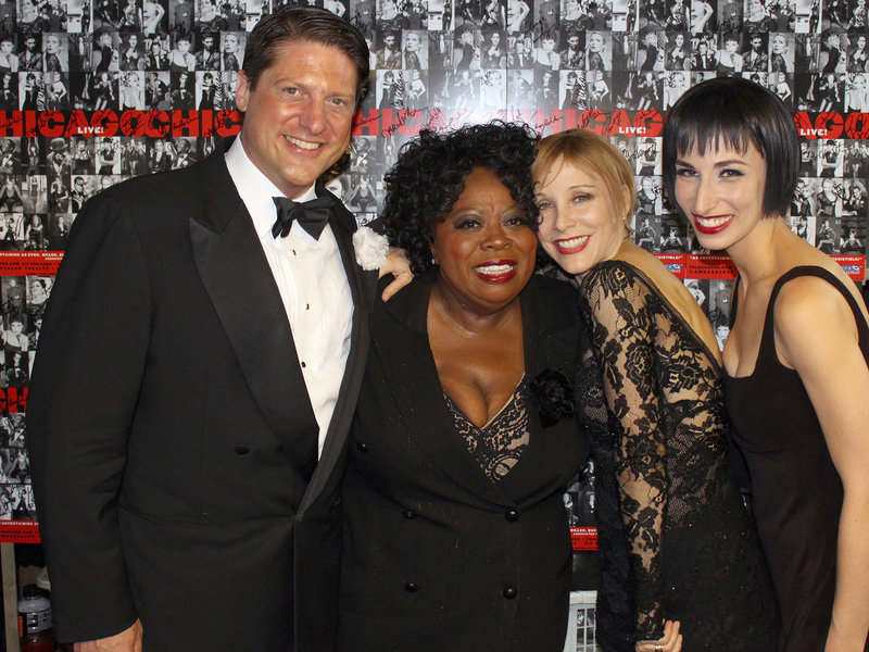 """""""Chicago"""" cast members Christopher Sieber (Billy Flynn), Carol Woods (Matron """"Mama"""" Morton), Nikka Graff Lanzarone (Velma) and Charlotte d'Amboise (a veteran Roxie Hart) pose for a photo Friday in New York."""