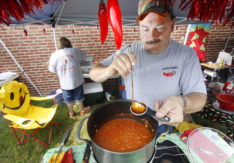 Rich Powell of AJ's Chili in Hudson, N.H., serves customers.