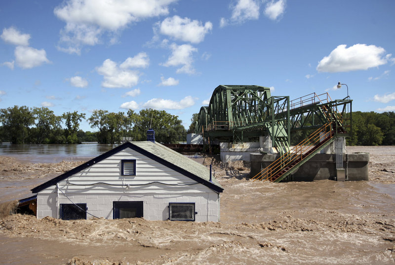 """Floodwaters overwhelm Lock 8 on the Erie Canal in Rotterdam, N.Y., on Monday in the aftermath of Irene. """"We were expecting flooding. We weren't expecting devastation,"""" said Bobbi-Jean Jeun of Clarksville, N.Y."""