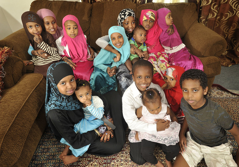 Children gathered at a party celebrating the end of Ramadan posed for a group photo.