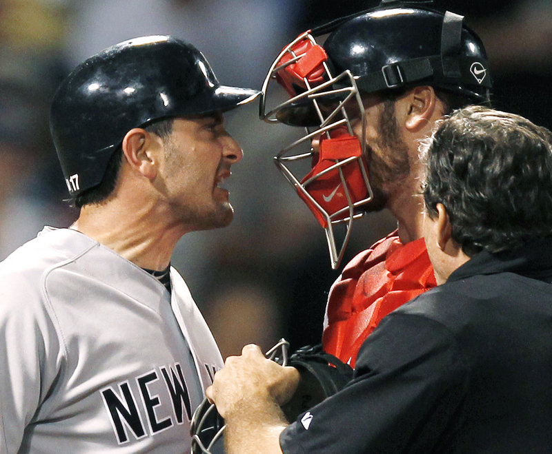 Francisco Cervelli of the Yankees jaws with Red Sox catcher Jarrod Saltalamacchia after getting hit by a John Lackey pitch in the seventh inning Tuesday night at Fenway Park.