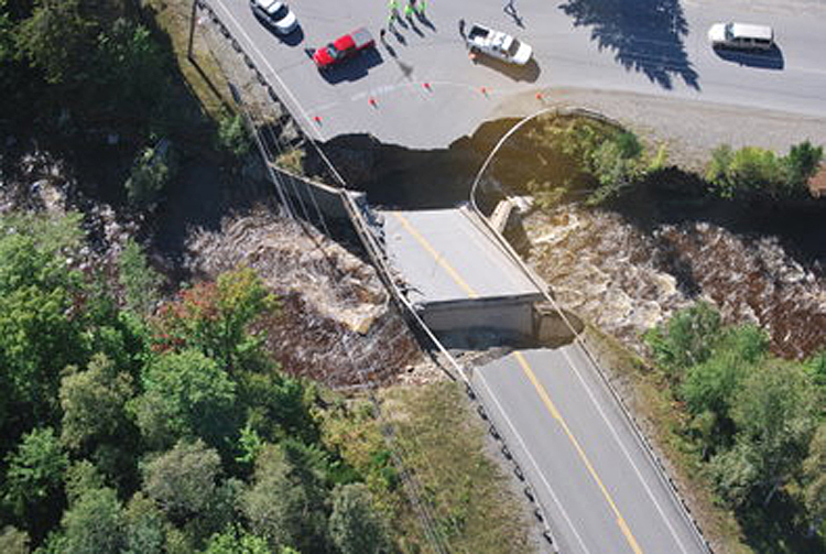 A bridge on Route 27 near the entrance to Sugarloaf ski resort shows flood damage from Tropical Storm Irene on Monday.