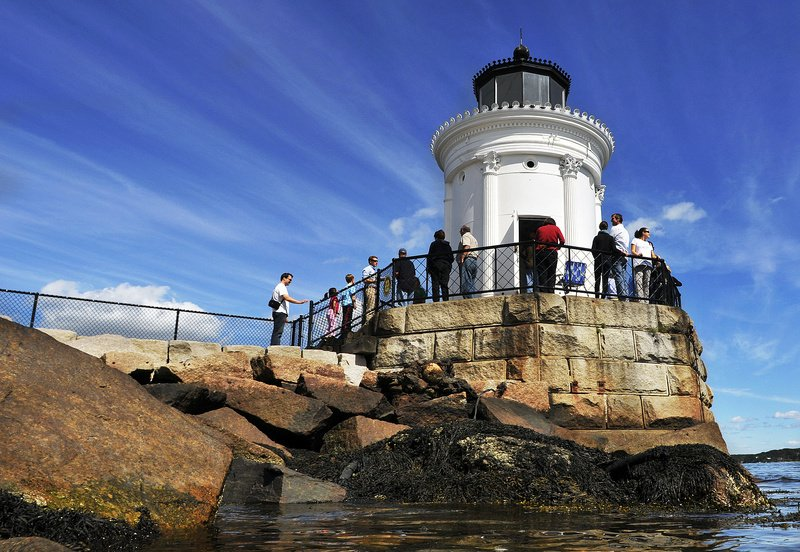 People mill around Bug Light in South Portland today for Open Lighthouse Day. The state opened access to a variety of lighthouses up and down the coast.