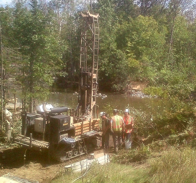 Work is underway Thursday morning to open Route 27 in Carrabassett Valley where two bridges were destroyed Sunday by Tropical Storm Irene. Temporary bridges are expected to open Tuesday.