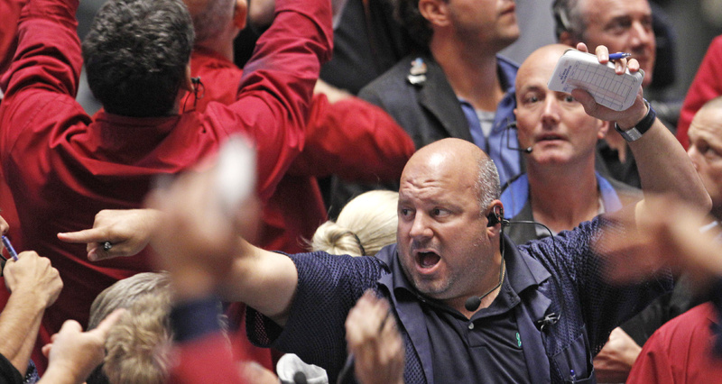 Traders work the S&P 500 Futures pit at the CME Group in Chicago Wednesday. Most markets fell after the Federal Reserve announced a plan to drive down long-term interest rates with the sale of more than $400 billion in short-term Treasurys.