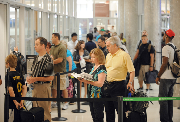 Airline passengers go through a security checkpoint at Hartsfield-Jackson Atlanta International Airport in Atlanta in this Aug. 3, 2011, photo.