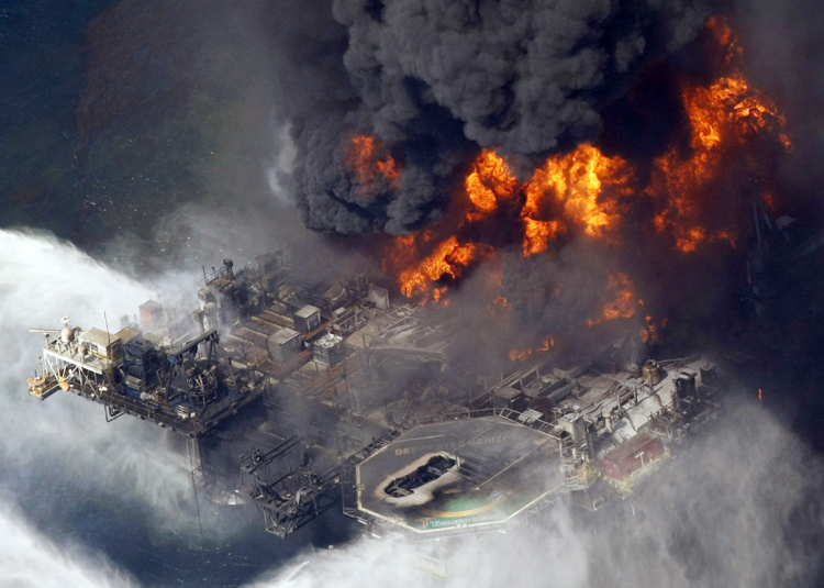In this April 21, 2010, photo, the Deepwater Horizon oil rig is seen burning in the Gulf of Mexico more than 50 miles southeast of Venice, La.