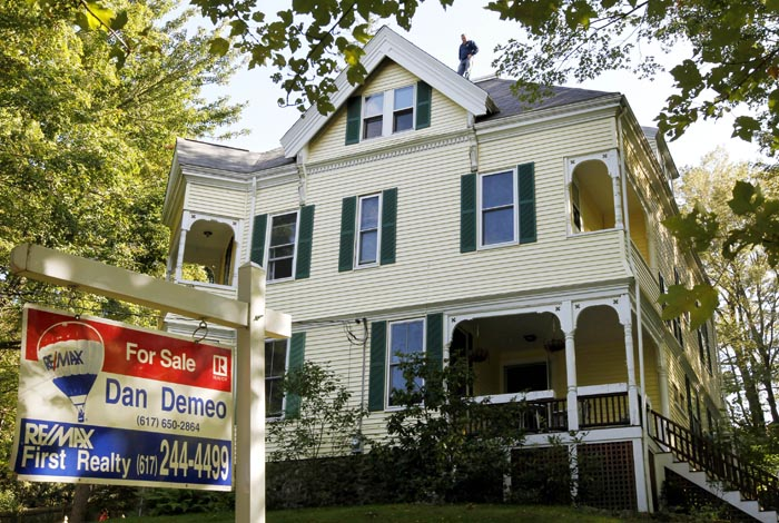 A home for sale in Newton, Mass. Many people are reluctant to purchase a home more than two years after the recession officially ended. Some can't qualify for loans or meet higher down payment requirements. Even those with good credit and stable jobs are holding off because they fear that home prices will keep falling.