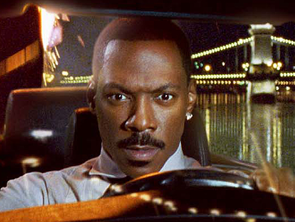 Eddie Murphy as special agent Kelly Robinson escapes on a car carrier while being pursued by villainous thugs in the action comedy