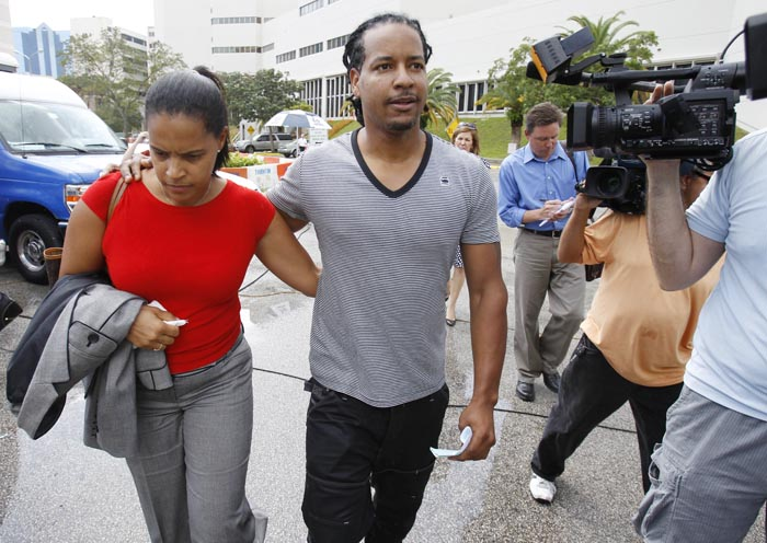 Manny Ramirez is escorted by an unidentified family member as he leaves the Broward County Jail in Ft. Lauderdale, Fla., today.