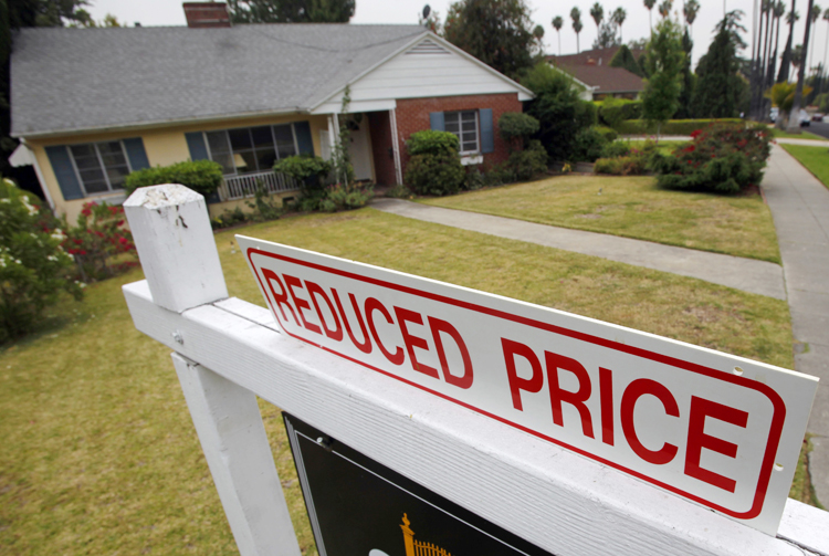 Americans' wealth declined this spring for the first time in a year, as stocks and home values fell.