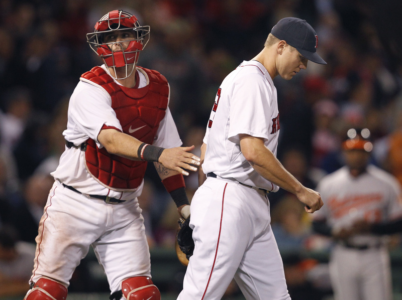 Catcher Jarrod Saltalamacchia pats closer Jonathan Papelbon on the back as Papelbon walks back to the mound after giving up a three-run double to Baltimore's Robert Andino in the eighth inning tonight at Fenway Park. Baltimore won, 7-5.