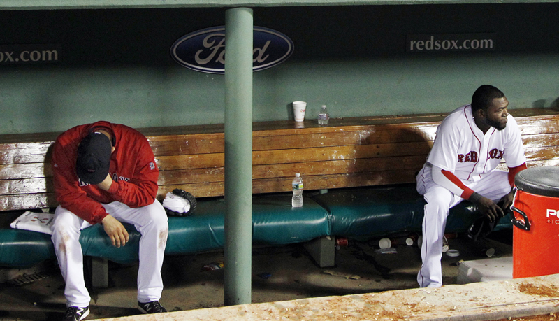 Relief pitcher Alfredo Aceves, left, and designated hitter David Ortiz react after the Red Sox fell to the Baltimore Orioles on Wednesday.