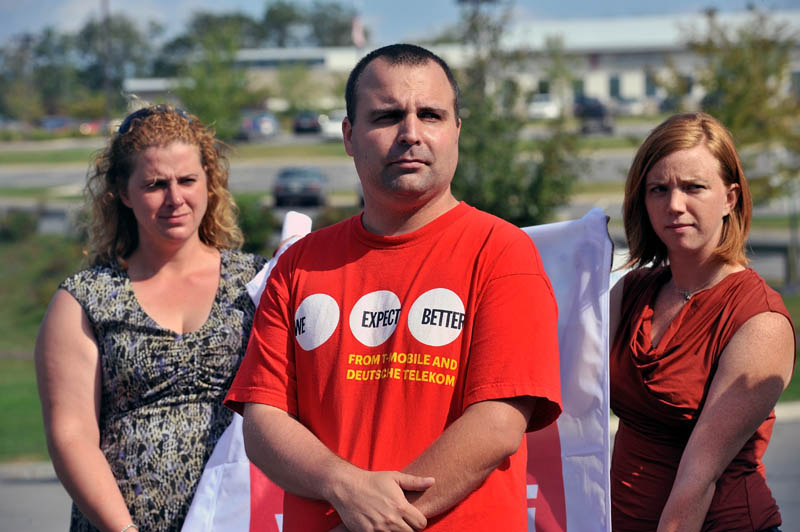 James McCoy, a current employee at T-Mobile, stands outside the Oakland call center Tuesday calling for the company to hire more employees or return taxpayer money. Behind him are Keri Evinson, with Communication Workers of America, and Tracy Allen, with the Maine AFL-CIO.
