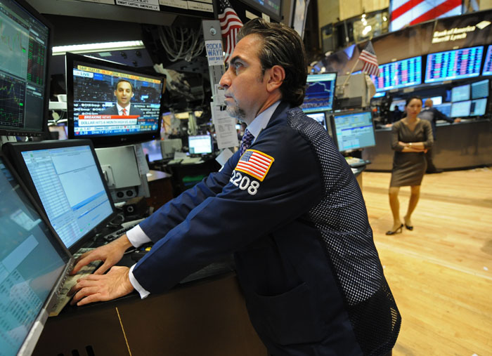A specialist works on the floor of the New York Stock Exchange this week.