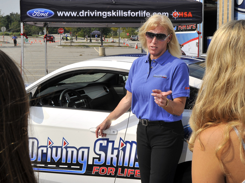 Stephanie Reaves, a lead driving instructor with the Ford Driving Skills for Life team, talks about car maintenance and safe driving at Scarborough High School on Wednesday. Reaves, who was raised in Freeport and Durham, will be at Bonny Eagle High School today.