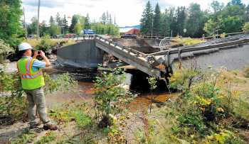 Ted Clark, a project manager for Reed & Reed General Contractors, surveys the damage to a bridge on Route 27 in Carrabassett Valley.