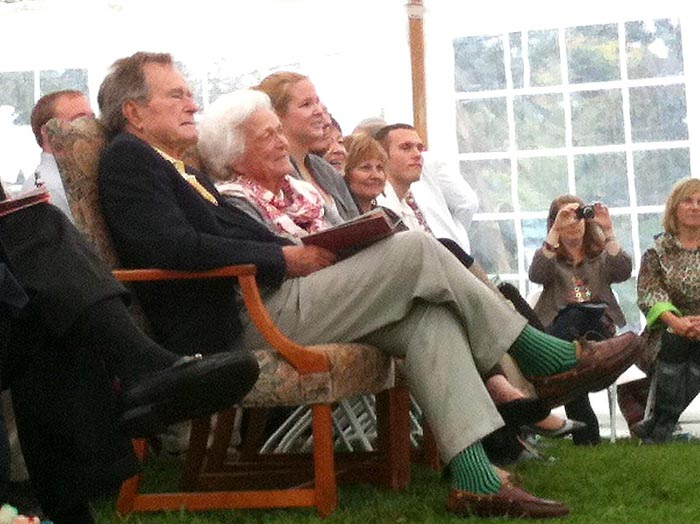 Barbara and George H.W. Bush listen to a speaker at the garden dedication ceremony in Kennebunkport today.