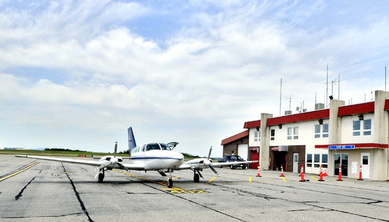 A Cape Air plane sits in front of the Augusta State Airport. The airline may pick up the federally subsidized service to several other Maine communities that Colgan Air intends to drop.