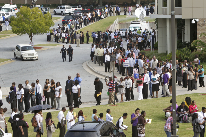 People wait in line during a job fair, sponsored by the Congressional Black Caucus, on the campus of Atlanta Technical College in Atlanta in August. Employers stopped adding jobs in August. CBC john lewis jobs employment unemployed job fair