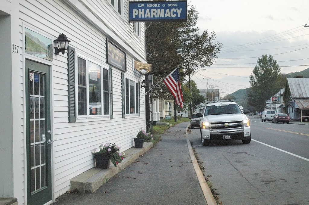 All was quiet outside E.W. Moore & Sons Pharmacy on Main Street in Bingham after it was robbed of drugs and money Monday night. Police kept the door locked as they interviewed witnesses inside. The investigation continued Tuesday.