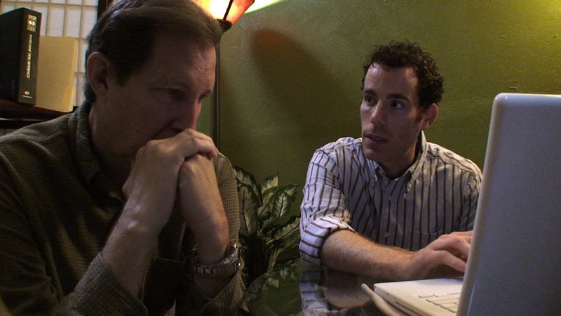 Lee Fulkerson looks at his blood results with Dr. Matthew Lederman in