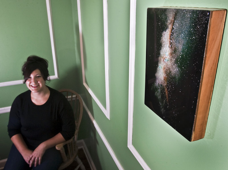 Erica Wren shows the first major piece of artwork she bought for her home in Leawood, Kan.