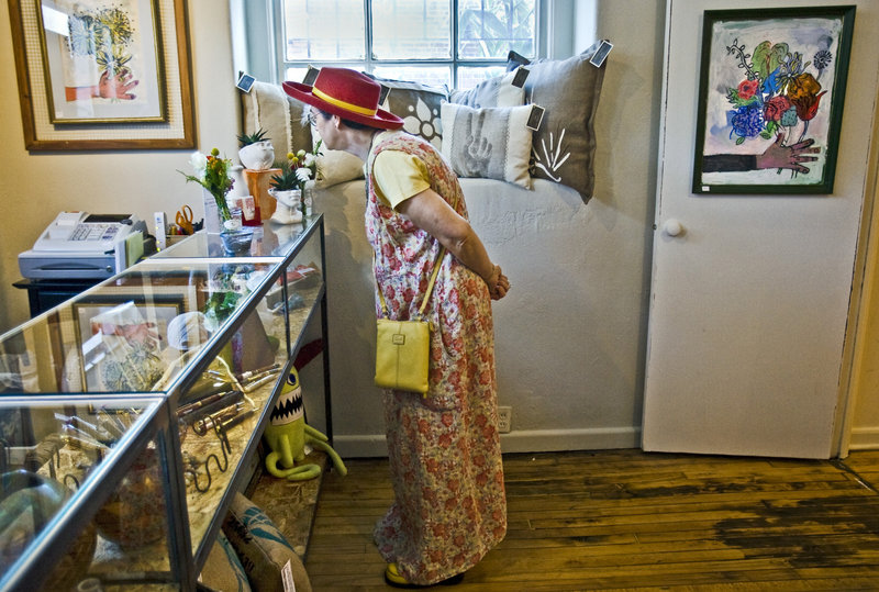Susan Krotzinger looks at items in the gift shop at the Leedy-Voulkos Art Center In Kansas City, Mo.