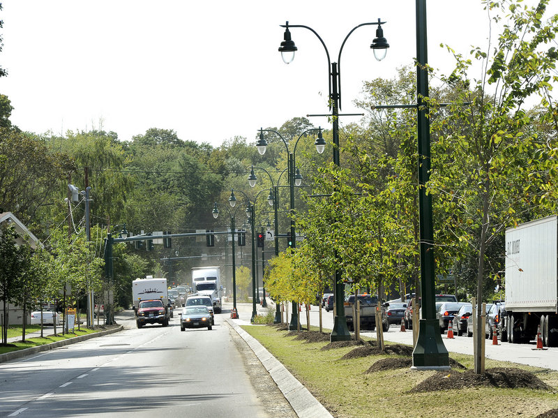 The landscaped median constructed this summer, complete with street lamps, is part of the improvement project for William L. Clarke Drive, the 1960s bypass around downtown Westbrook. The project includes reconfiguring intersections and coordinating traffic lights.