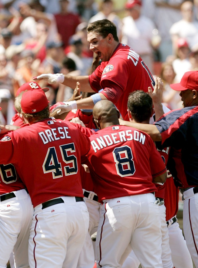 The Washington Nationals' Ryan Zimmerman leaps onto home plate after hitting a game-winning home run against the New York Yankees on June 18, 2006.